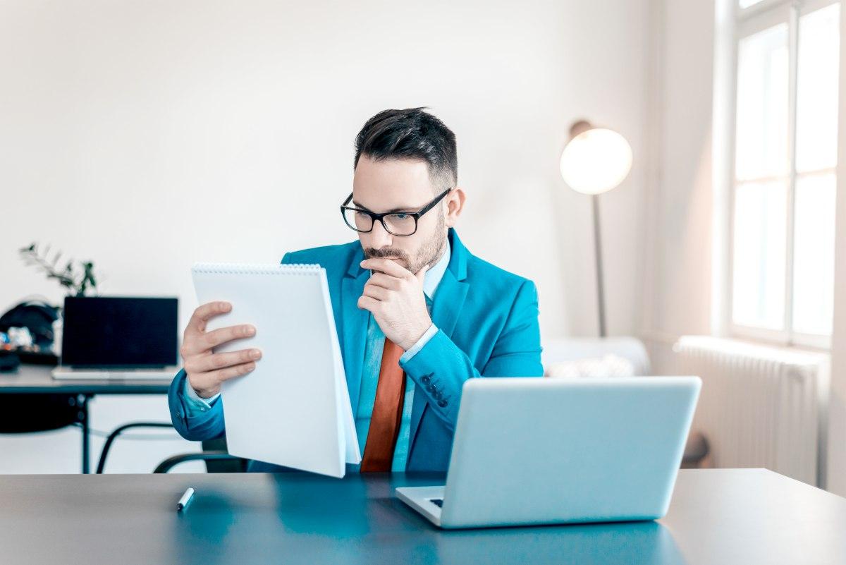 businessman reading documents | Best Effective Account Management Strategies | account management
