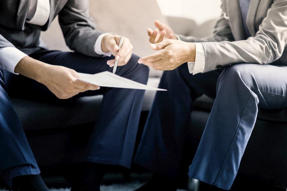 Two businessman discussing work   Salesperson Skills Of Top Performers [INFOGRAPHIC]   salesman   define sales associate   sales skills resume